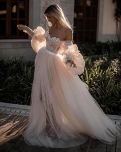 Photo byTali Photographywith gown byGalia Lahav