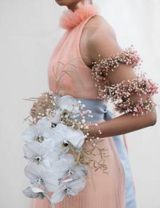 Photo byElizabeth Messinawith floral design byTulipina